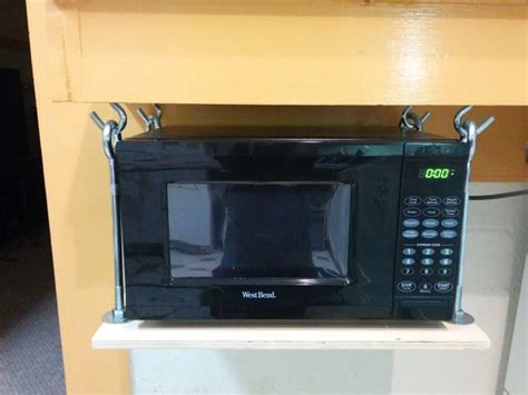 how to hang a microwave under a cabinet hanging microwave shelf