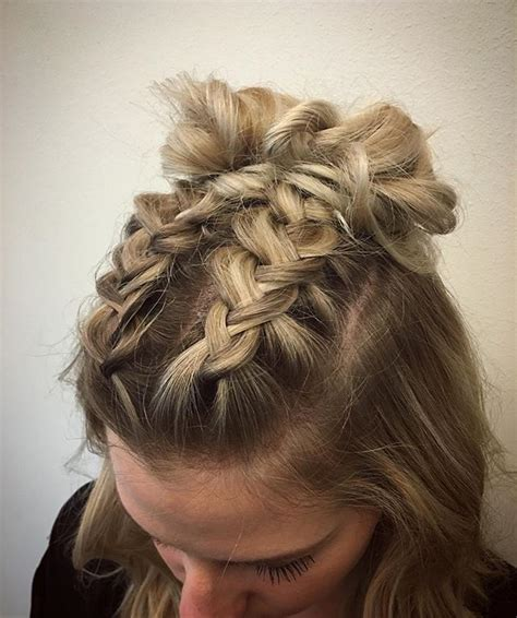 double dutch braids finished into buns for this cute