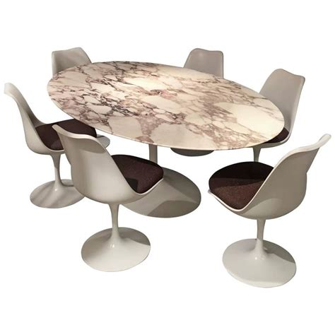 eero saarinen calacatta marble table and tulip swivel