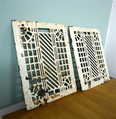 pair chippy floor heating grate or trivet metals deco and