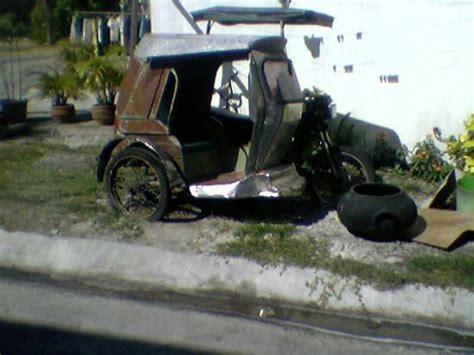 A Broken Down Motorcycle Trike. A Major Source Of Public