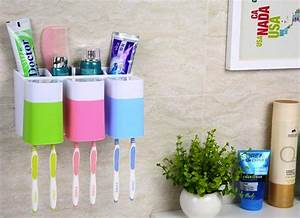 Wall mounted toothbrush holder the best organizers to for Best way to store toothbrush in bathroom