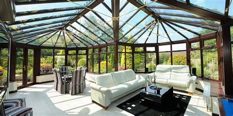 large bespoke conservatory witgh glass roof permaframe