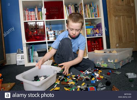 Bedroom Tidying by Boy Tidying Toys In His Bedroom Stock Photo Royalty