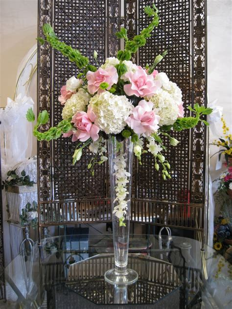 Pink White And Green Wedding Centerpiece With Roses