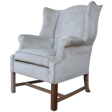 pair of modern sculptural wingback lounge chairs in grey
