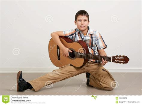 Song maker, an experiment in chrome music lab, is a simple way for anyone to make and share a song. Boy Having Fun With Guitar, Making Music And Singing Stock Image - Image of having, making ...