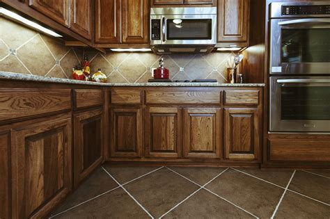 tile flooring cabinets enorm rustic kitchen floor tiles best beige tile flooring for with wooden cabinet 25366 kitchen