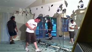 Demolishing a glass mirror wall youtube for How to remove a mirror from a bathroom wall