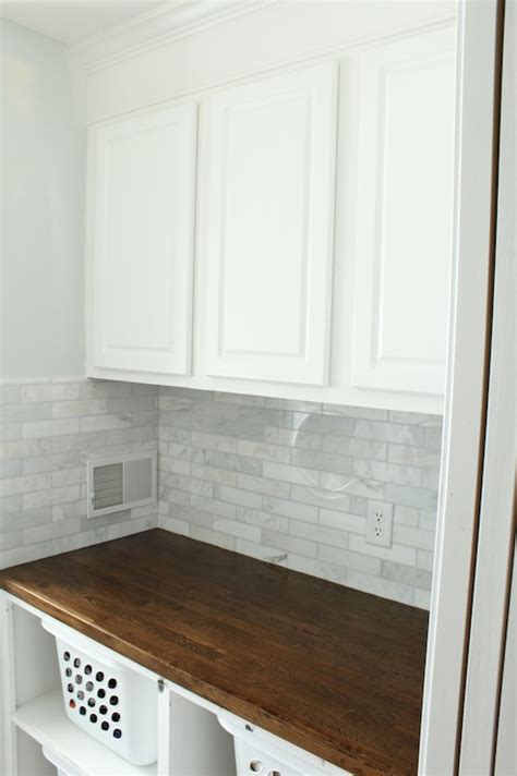laundry room tile linear marble tile backsplash traditional laundry room just a girl