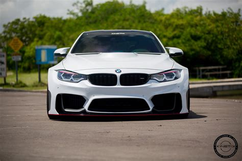 bmw m4 widebody alpine white widebody bmw m4 gets kinetic wheels