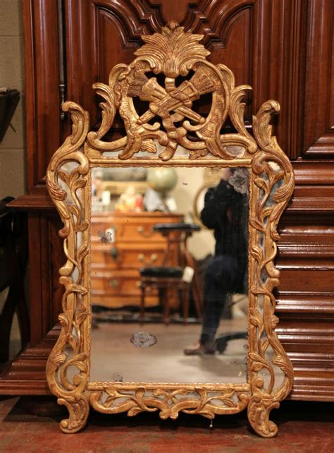 century french louis xv carved giltwood mirror