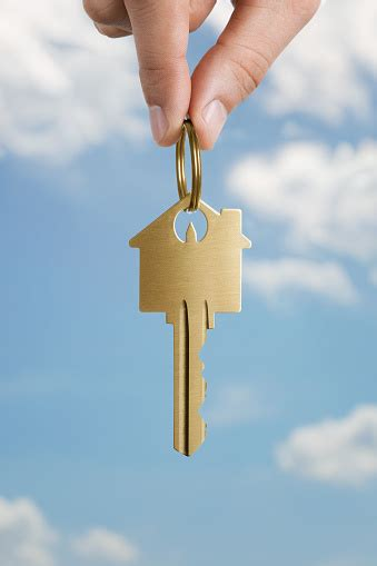 human hand holding house shaped key stock photo  image  istock
