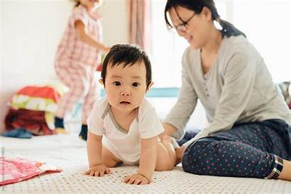 Mother Chinese Daughter Son Stocksy Bed Young