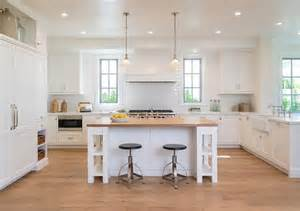 white kitchen islands with seating kitchen peninsula with pass through and glass front beverage fridge transitional kitchen