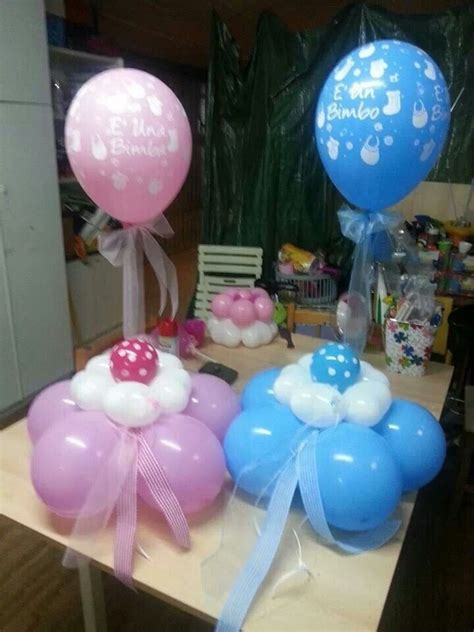 baby shower centerpieces with balloons do this as a centerpiece base with 5 balloons a pacifier on top of base or 3 to set on gift or