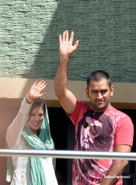 dhoni and his wife sakshi spotted at the balcony of their home in ranchi cinema gallery