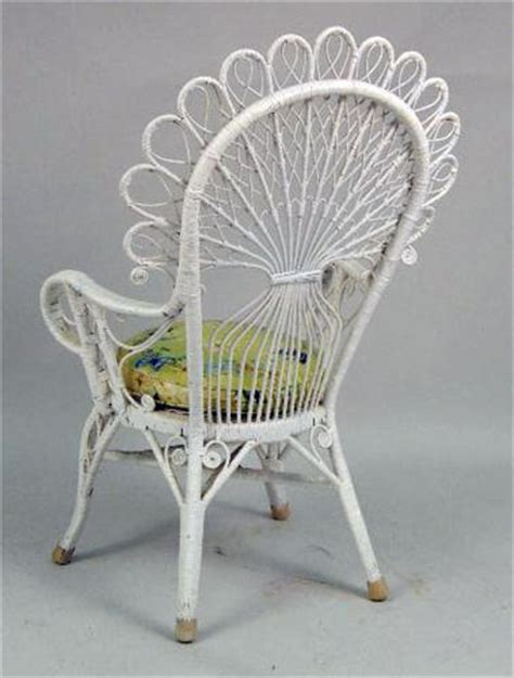 a white painted wicker peacock chair