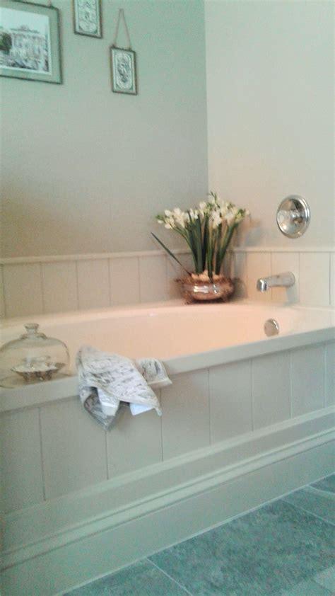 vinyl flooring around bathtub diy tub surround using peel and stick vinyl planks to create shiplap look finished master