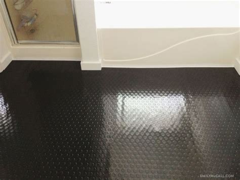 Rubber Floor Tiles For Bathrooms by Black Raised Rubber Flooring In The Bathroom Emilymccall