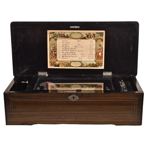 """This fine swiss music box plays eight songs and has a beautiful sound. Swiss 8"""" Cylinder Music Box - Renaissance Antiques"""