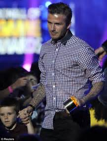 David Beckham shares the limelight with son Cruz as he's ...