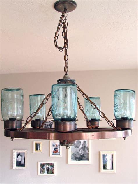 wagon wheel light with mason jars wagon wheel light fixture with blue mason jars craft
