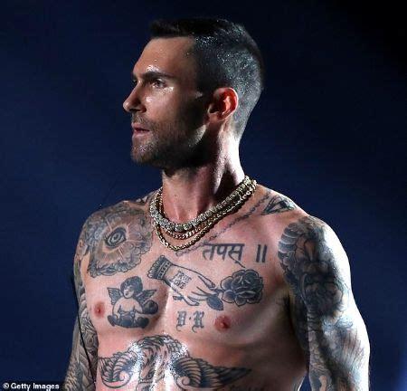 complete details  adam levine tattoos glamour fame