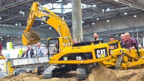 gigantic cat caterpillar excavator  work rc model scale  fair leipzig germany  youtube