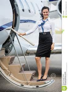 free small cabin plans stewardess standing on ladder of jet royalty free
