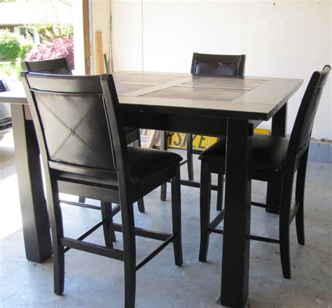 black distressed pub style dining table for the home
