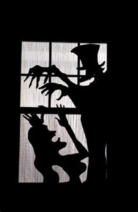 scary halloween window silhouettes  shadows halloween