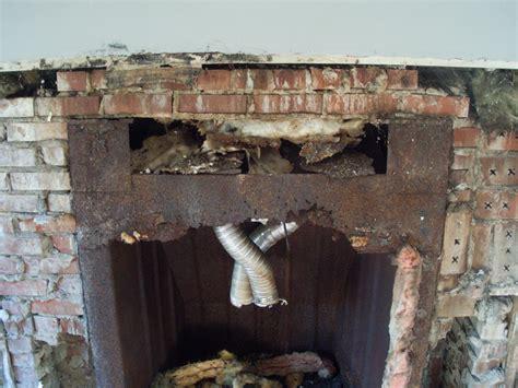 tore  brick fireplace facade    concrete