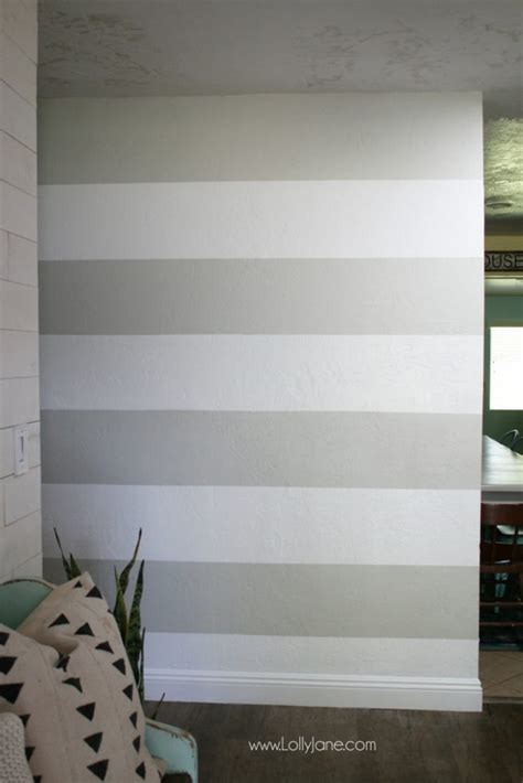 diy striped accent wall with gray white stripes lolly