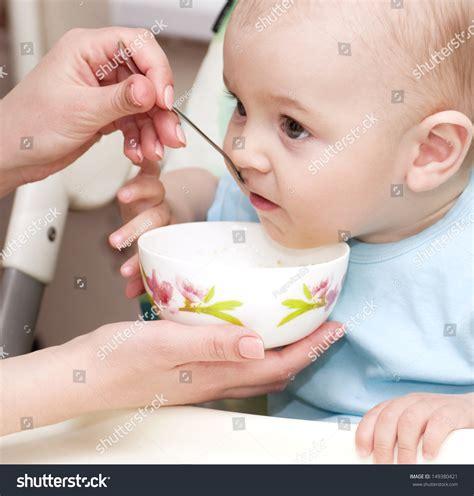 Mothers Hand Feeding Baby Boy Stock Photo 149380421