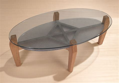 The design of oval glass coffee table is simple yet elegant. Oval Glass Coffee Table   Shop Oval Cocktail tables   Stoneline Designs
