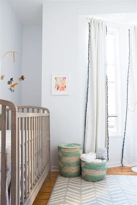 Crib Drapes - nursery with black and white pom pom curtains