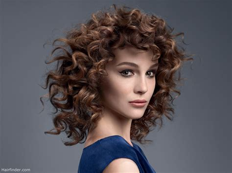 medium hair with spiral curls and shorter bangs