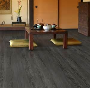 vinyl plank flooring trafficmaster in iron wood going in the living room kitchen and