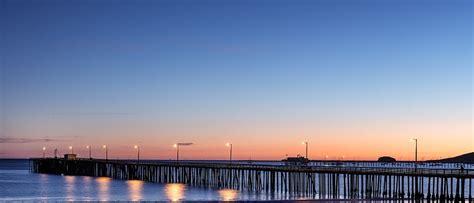 photo pier sunset water ocean  image  pixabay
