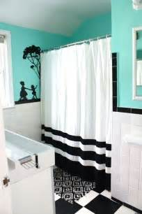 teal bathroom with grey black and white house