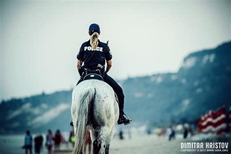 police officers riding horses   beach ka photo blog