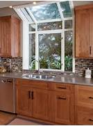 Window Over Kitchen Sink This Lovely Window Doesn T Stop At The Edge Bay Window Above Kitchen Sink Small Kitchen Bay Window Kitchen Window Treatments Kitchen After Remodeling By Newman Wolen Design With Bay Window Over
