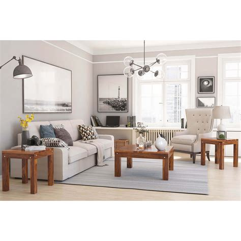 Each piece is crafted from solid and engineered wood with shapely, turned legs and a natural brown finish that highlights all the organic variations in the wood. Patet Contemporary Rustic Solid Wood 3 Piece Coffee Table Set