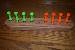 Eight Frogs on a Log Peg Game - WoodLogger