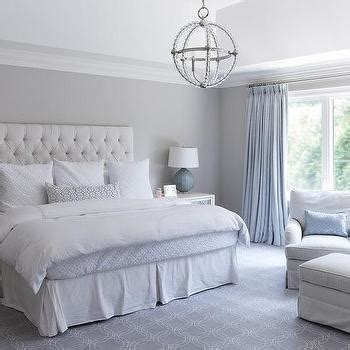 light gray bedroom with ivory curtains transitional