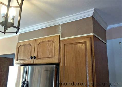Add height to uneven cabinets to bring to ceiling.   Ideas