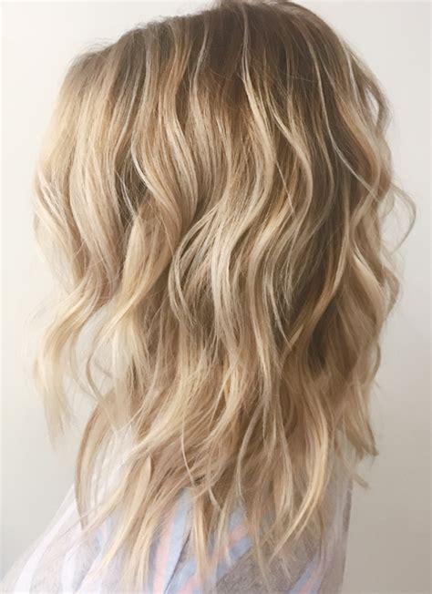 warm toned blonde balayage medium length hairstyles