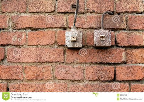 light switches on brick wall image 23952452