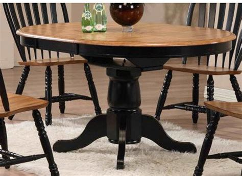 rustic oak round dining table missouri round black rustic oak single pedestal table only